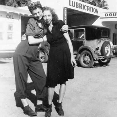 Two 40s girls in pants and dress